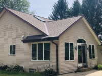 Wisconsin Roofing LLC | Menomonee Falls | Residential | Landmark Heather Blend | New roof with poor flashing from age side view