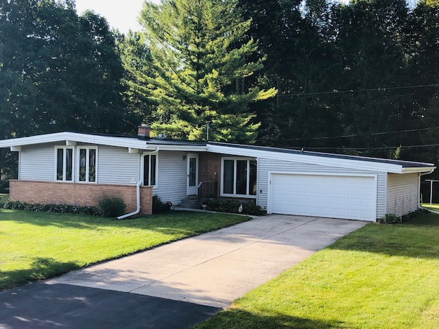 Wisconsin Roofing LLC | Menomonee Falls | Residential | New Rubber Flat Roof | was leaking and had poor detail work prior to upgrading their exhaust for kitchen and bathroom ventilation front view