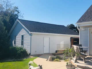 Wisconsin Roofing LLC | Pewaukee | Residential | Landmark Pro Moire Black | Side Garage