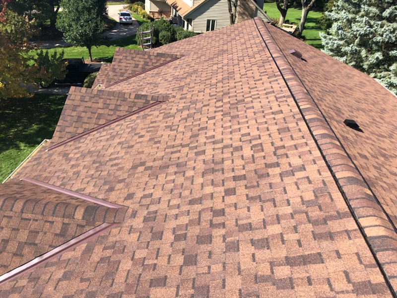Wisconsin Roofing LLC | Brookfield | Upgraded Ventilation Unblocked Soffit Vents | Baffled Intake Chutes | CertainTeed Landmark Burnt Sienna Shingles | Ridge