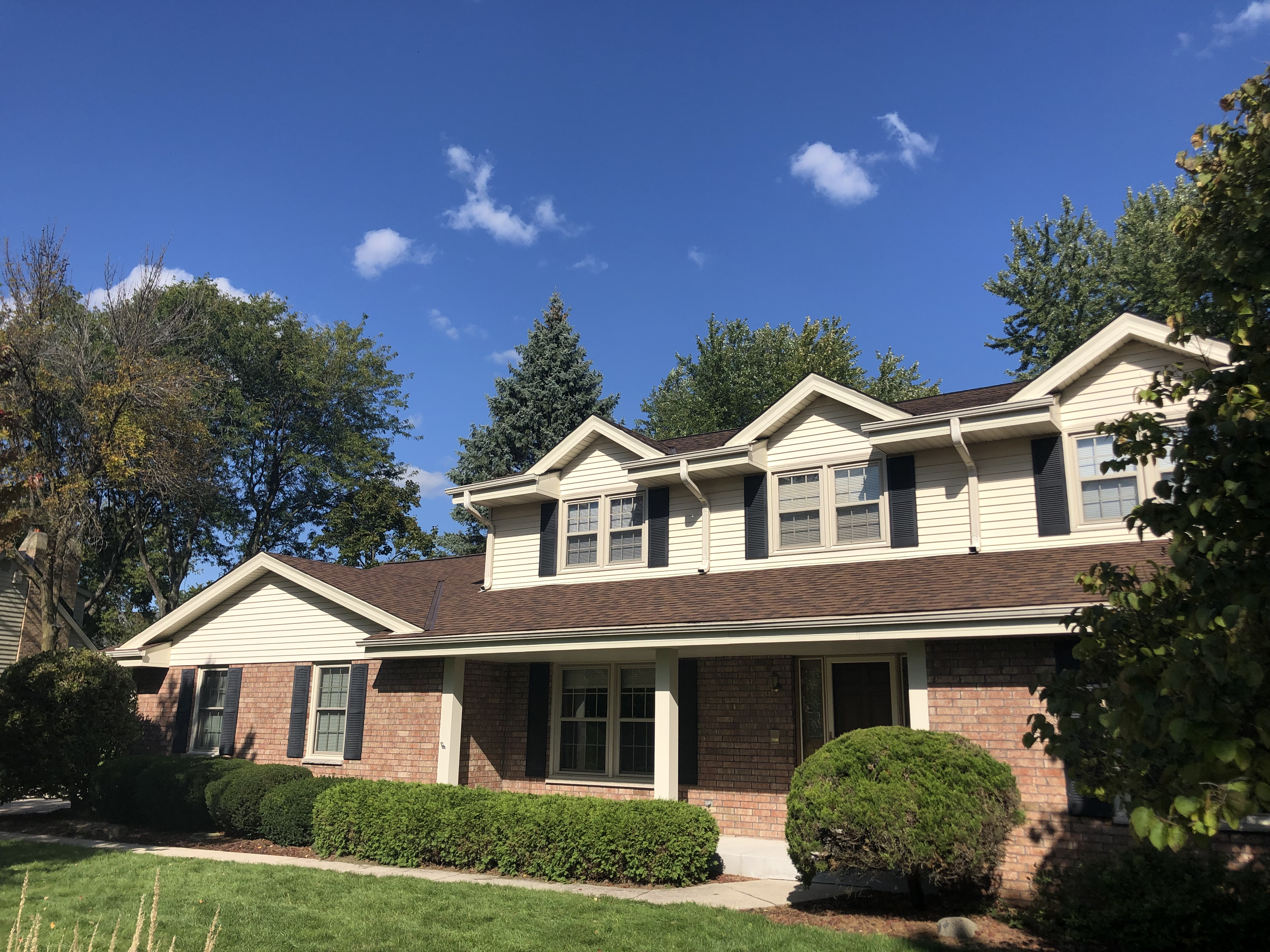 Wisconsin Roofing LLC | Brookfield | Upgraded Ventilation Unblocked Soffit Vents | Baffled Intake Chutes | CertainTeed Landmark Burnt Sienna Shingles | Side