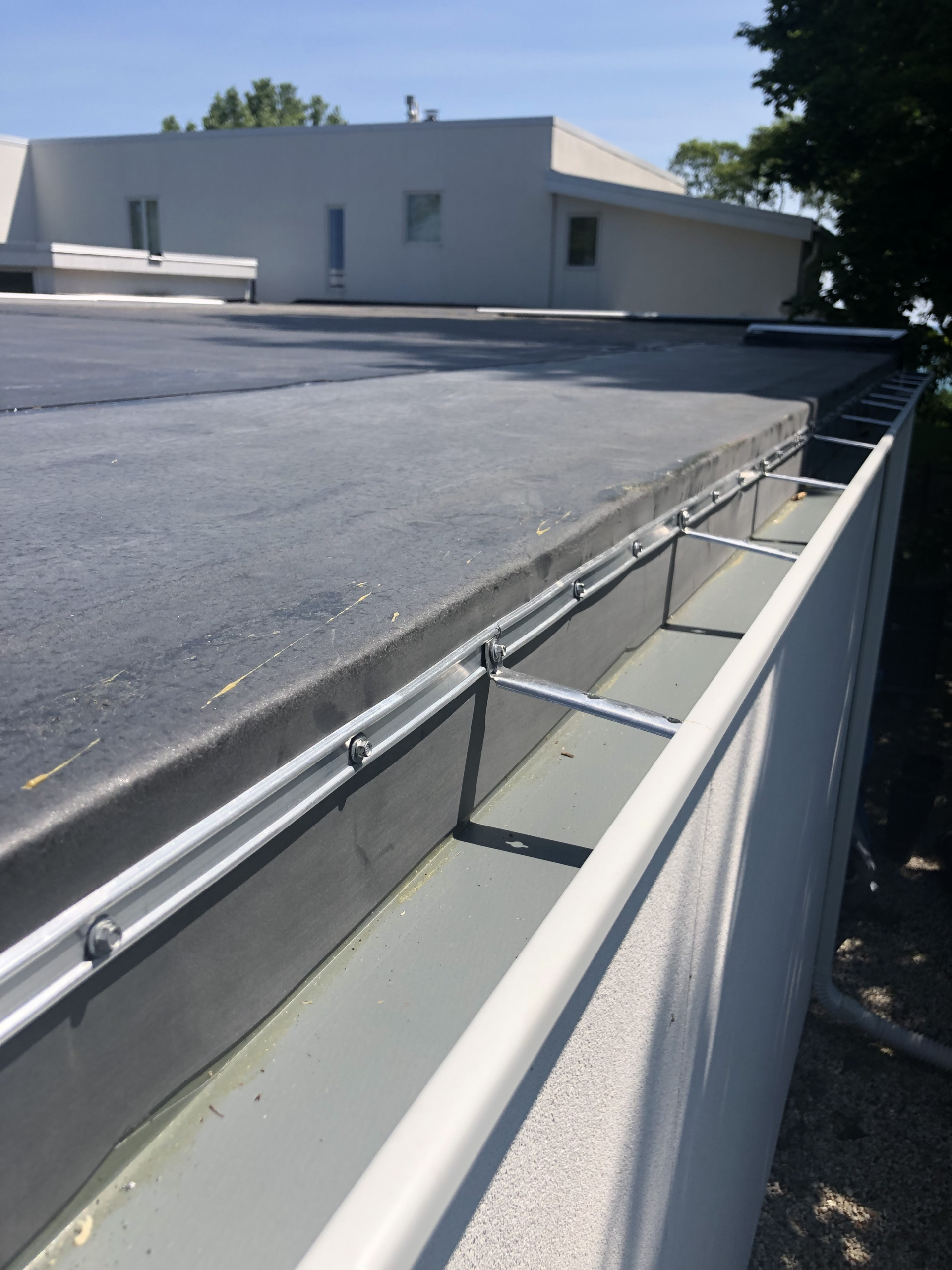 Wisconsin Roofing LLC | Commercial | Flat Deck | Gutter | Mequon