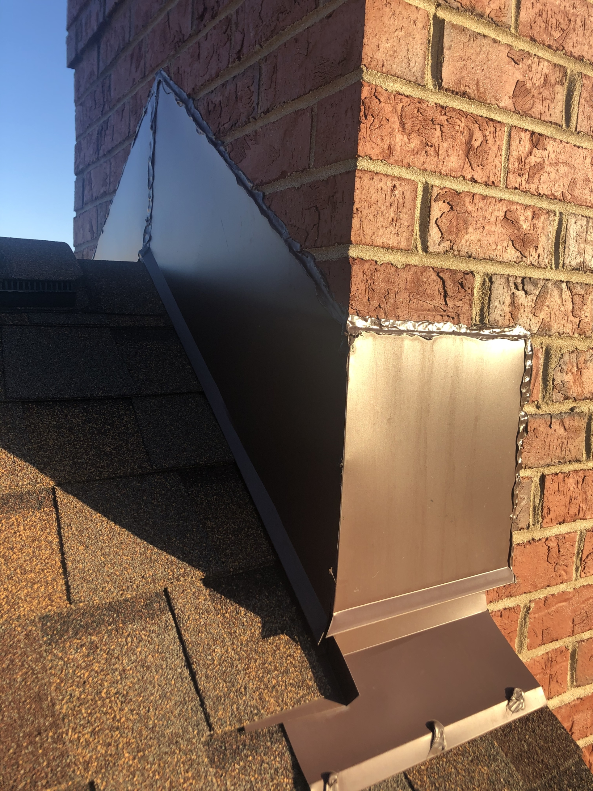 Wisconsin Roofing LLC | Residential | Brookfield | Chimney flashing on ridge