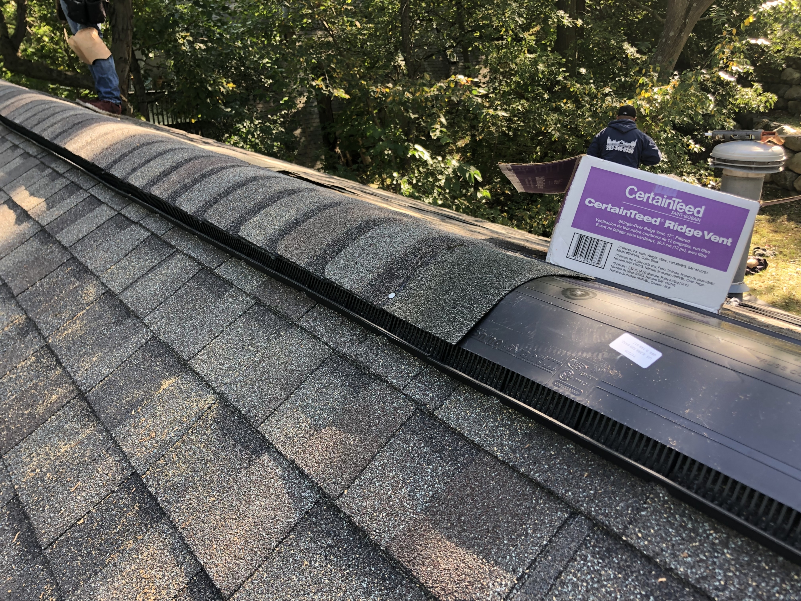 Wisconsin Roofing LLC | Residential | Cedarburg | New ridge vent and reinforced ridge cap shingles installed correctly
