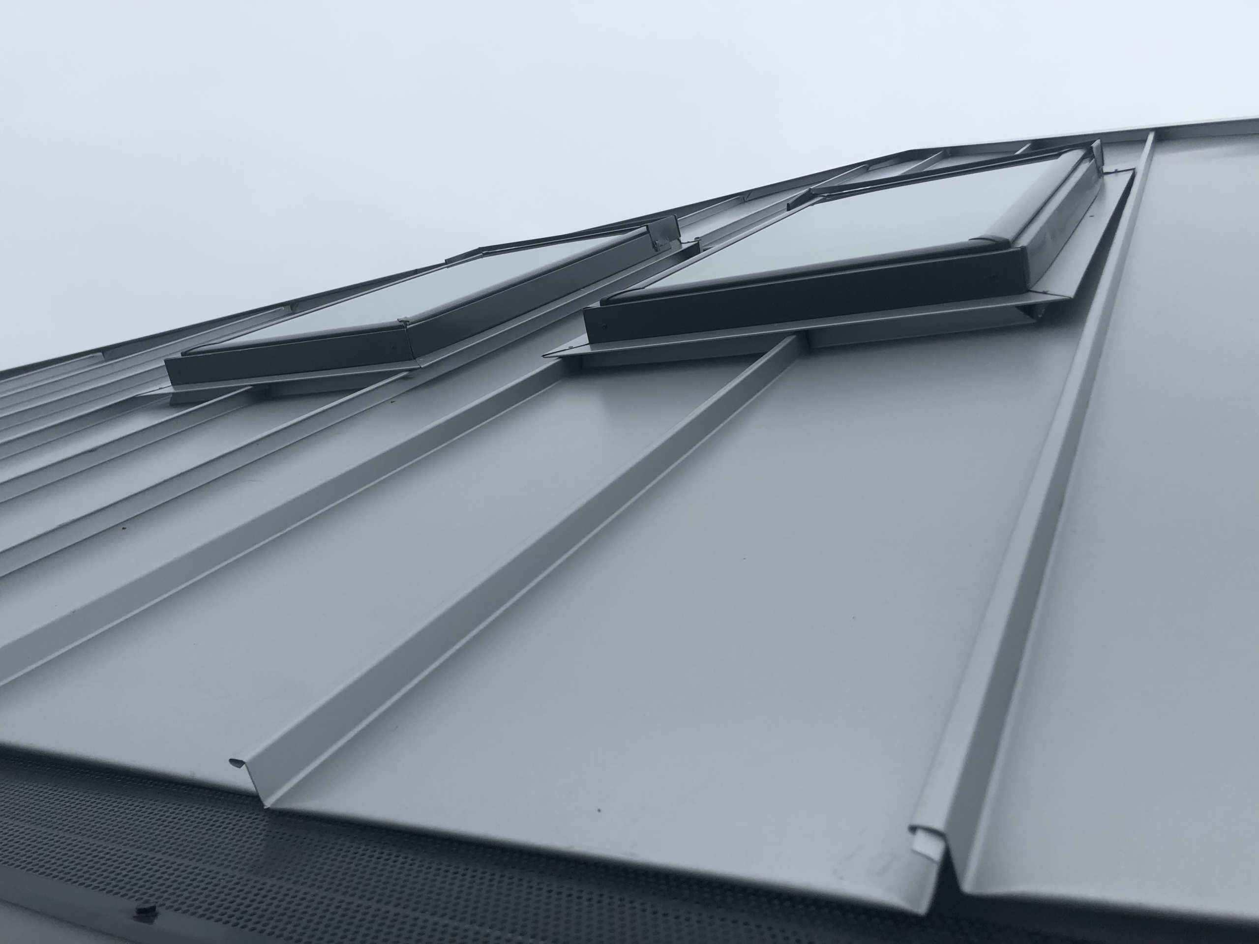 Wisconsin Roofing LLC | Residential | Elkhart Lake | Metal roof and side view of skylights
