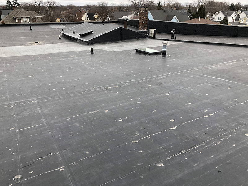 Wisconsin Roofing LLC | Fond Du Lac | Commercial Roofs | EPDM Rubber Tapered Insulation Custom Drains