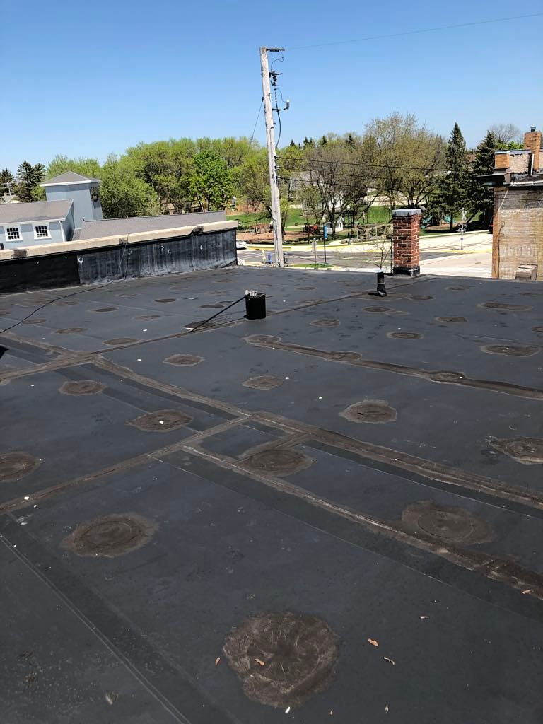 Wisconsin Roofing LLC | Case Study | Hugh Lomas | Low Slop Roof | Before Upper Rubber