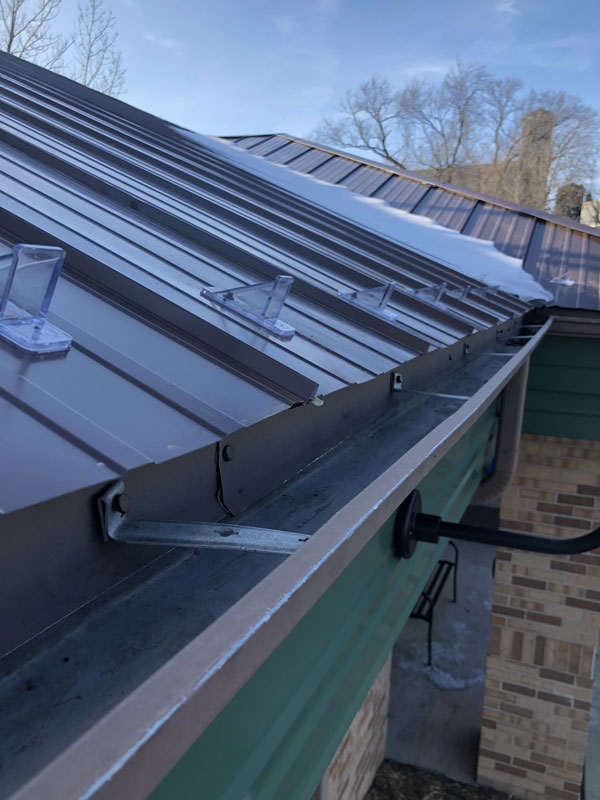 Commercial Metal Roof Before Gutter Damage