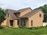 Wisconsin Roofing LLC | Cedarburg | Residential | Landmark Burnt Sienna | Custom house with new roof side
