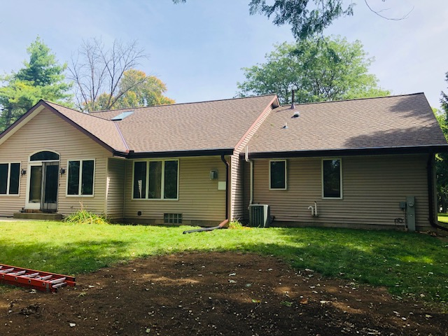 Wisconsin Roofing LLC | Menomonee Falls | Residential | Landmark Heather Blend | New roof with poor flashing from age back view