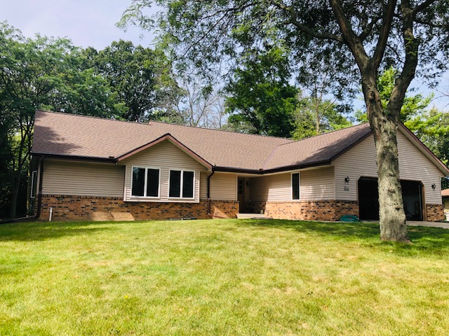 Wisconsin Roofing LLC | Menomonee Falls | Residential | Landmark Heather Blend | New roof with poor flashing from age front view