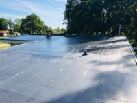 Wisconsin Roofing LLC | Menomonee Falls | Residential | New Rubber Flat Roof | was leaking and had poor detail work prior to upgrading their exhaust for kitchen and bathroom ventilation roof view