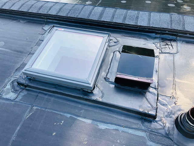 Wisconsin Roofing LLC | Menomonee Falls | Residential | New Rubber Flat Roof Was leaking and had poor detail work prior to upgrading their exhaust for kitchen and bathroom ventilation