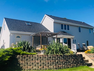 Wisconsin Roofing LLC | Pewaukee | Residential Landmark Pro Moire Black | Backyard