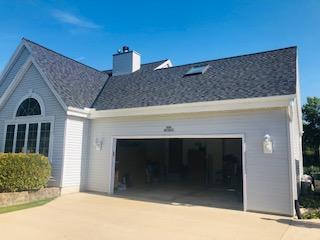 Wisconsin Roofing LLC | Pewaukee | Residential | Landmark Pro Moire Black | Garage