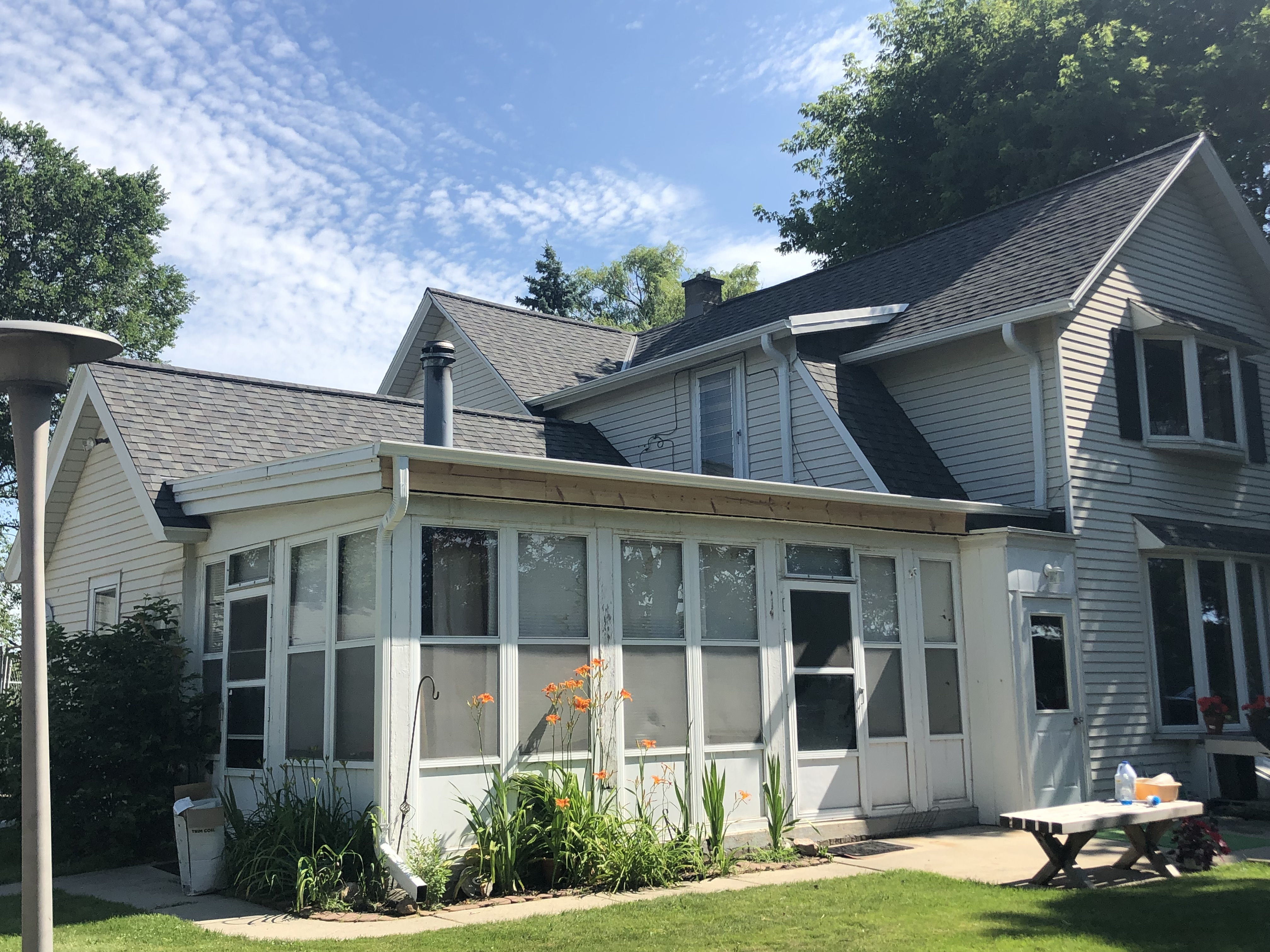 Wisconsin Roofing LLC | Germantown | Residential | New Roof | Added intake and exhaust ventilation difficult farm house | custom transitions | Prior rubber roof done poorly that leaked | Re-framed perimeter