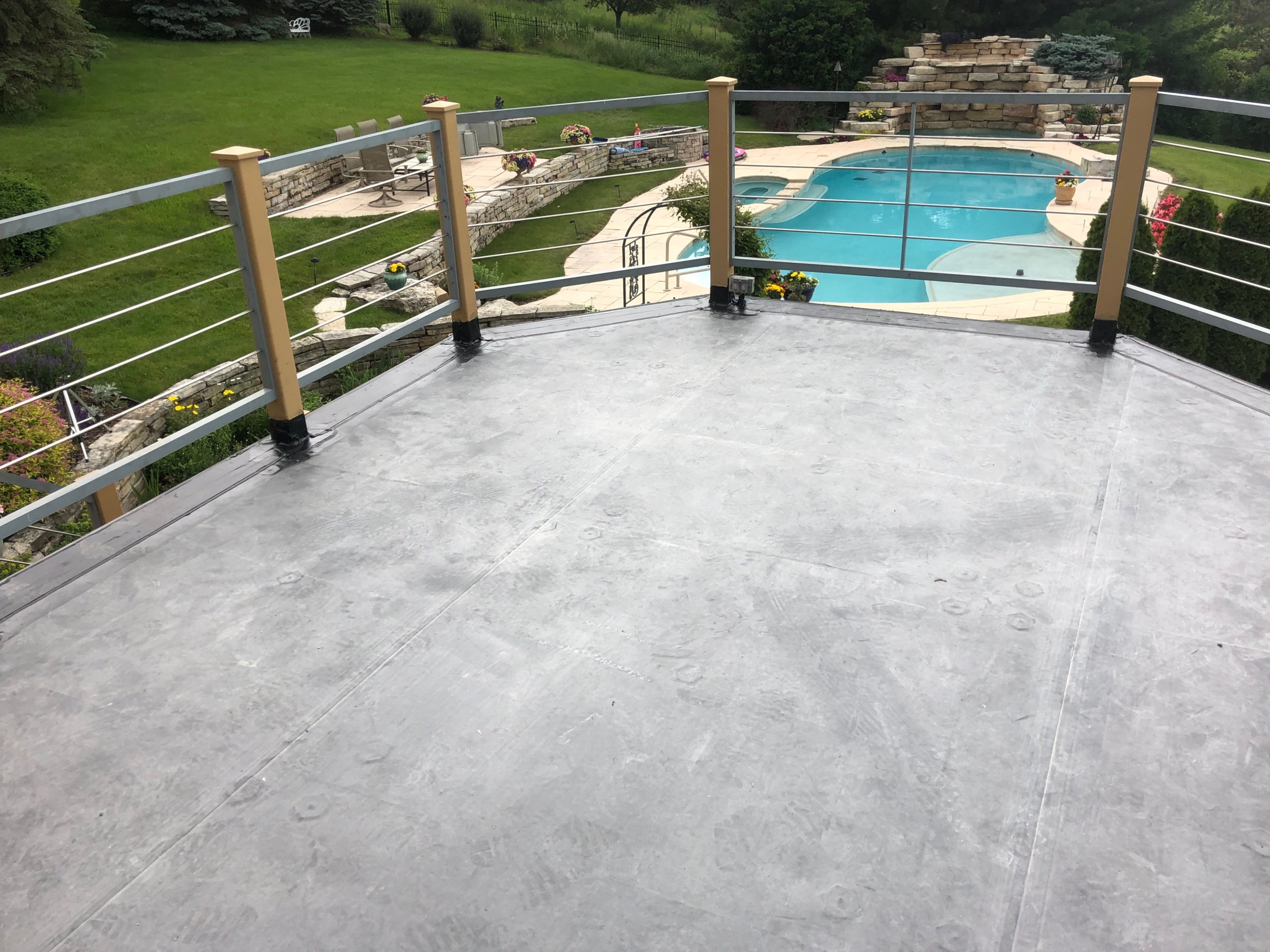 Wisconsin Roofing LLC | Best Work | Flat Deck | Backyard | Waukesha