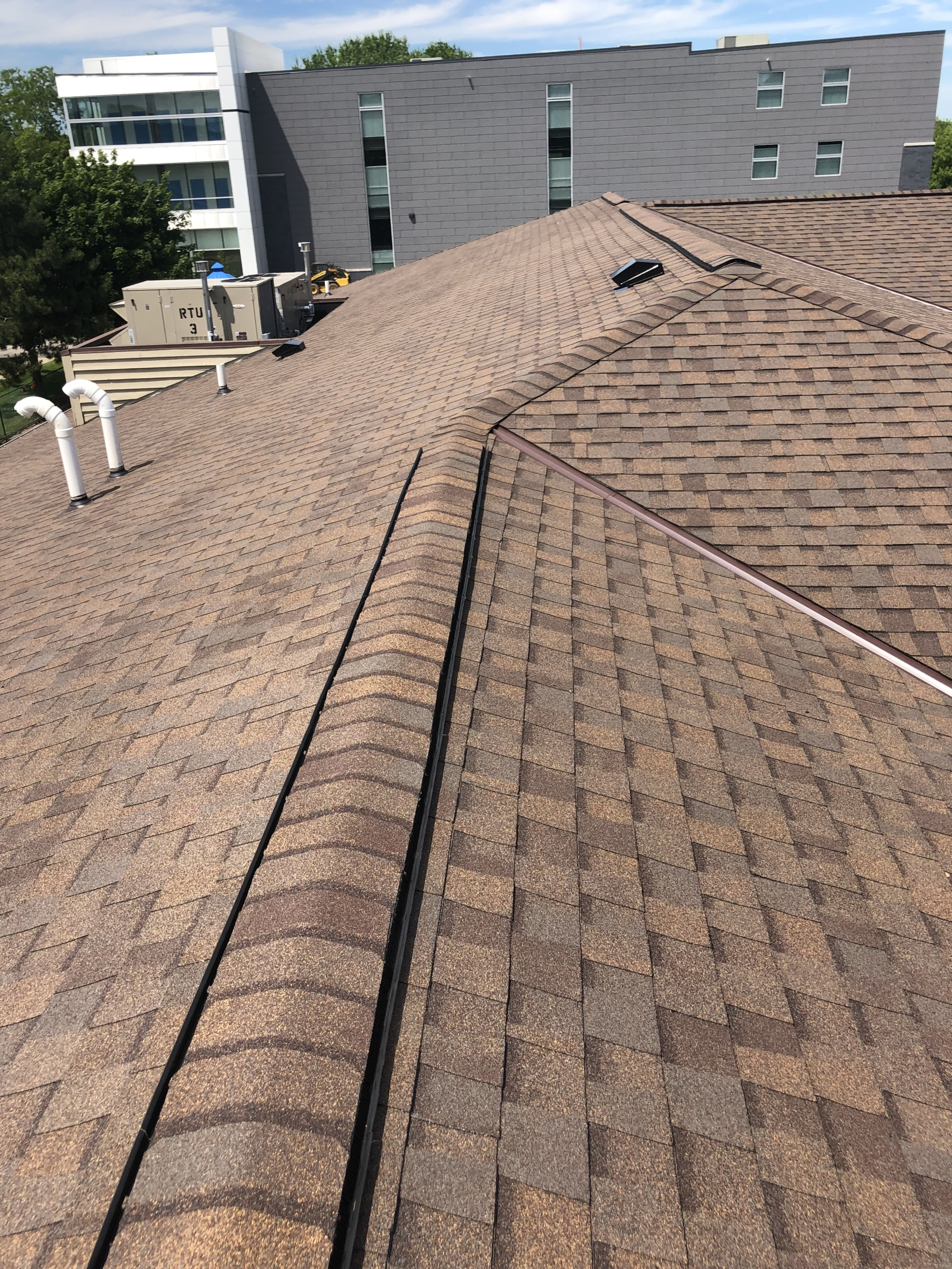 Wisconsin Roofing LLC | Commercial | Shingle Roof | Top | Hartland