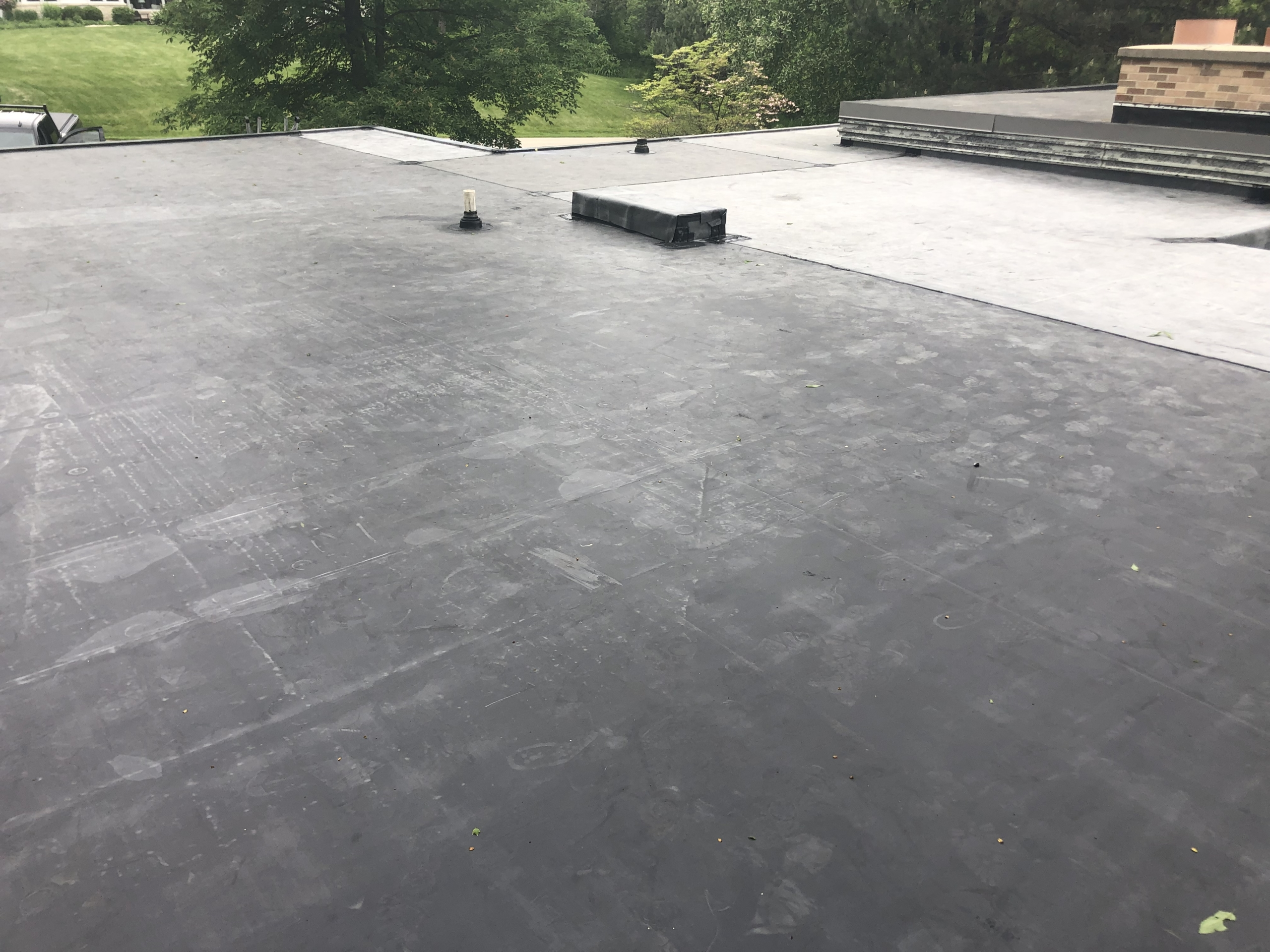 Wisconsin Roofing LLC | Flat Deck | Cleanup | Brookfield