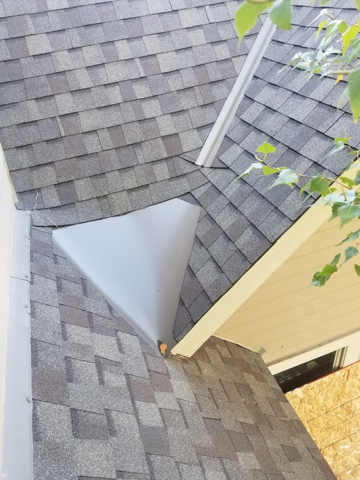 Wisconsin Roofing LLC | Residential | Elkhart Lake | Custom metal pan to divert water | water drainage issue | leak