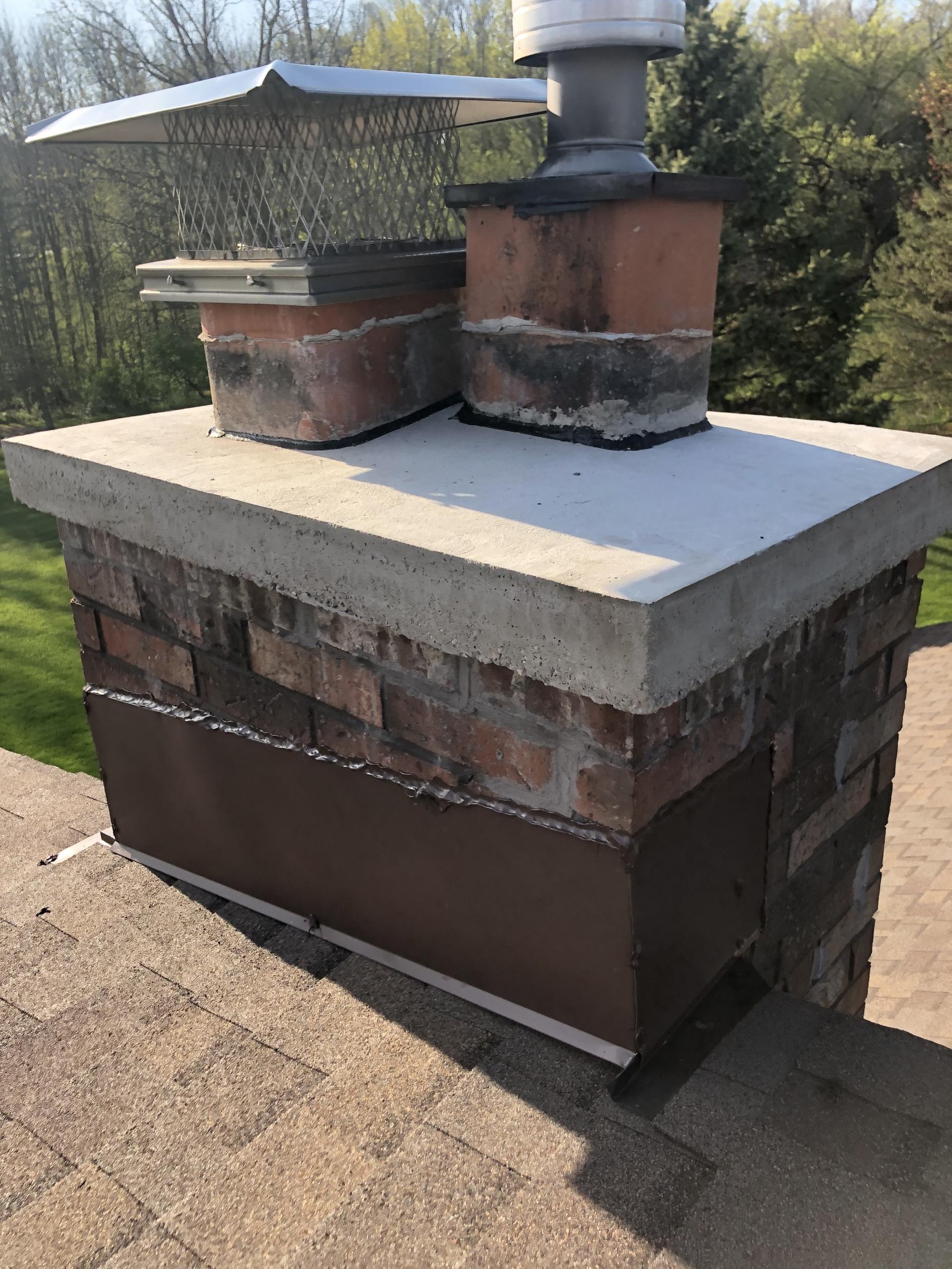 Wisconsin Roofing LLC | Residential | Kohler | Custom chimney diverter flashing