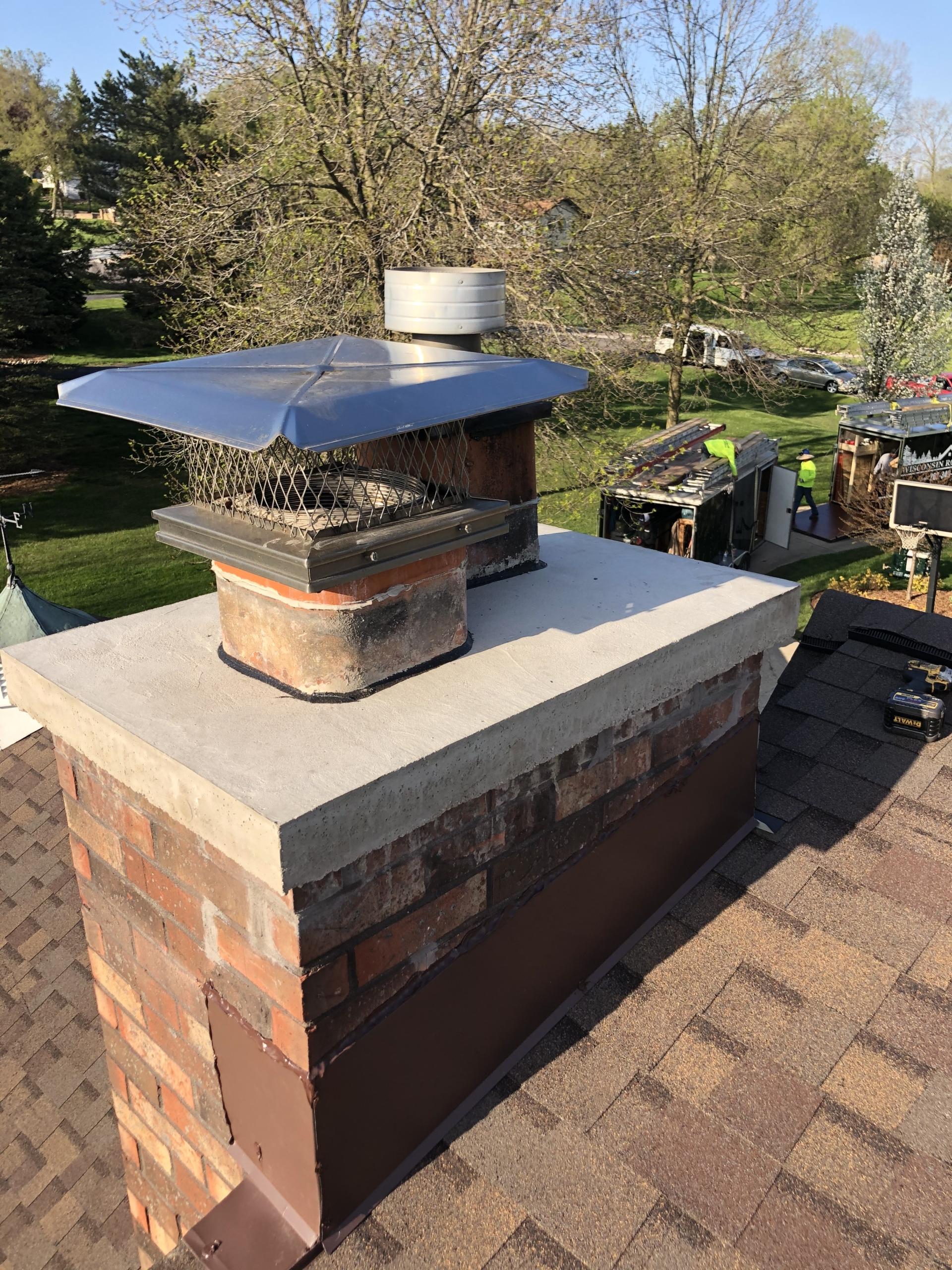 Wisconsin Roofing LLC | Residential | Kohler | Custom chimney diverter flashing top view