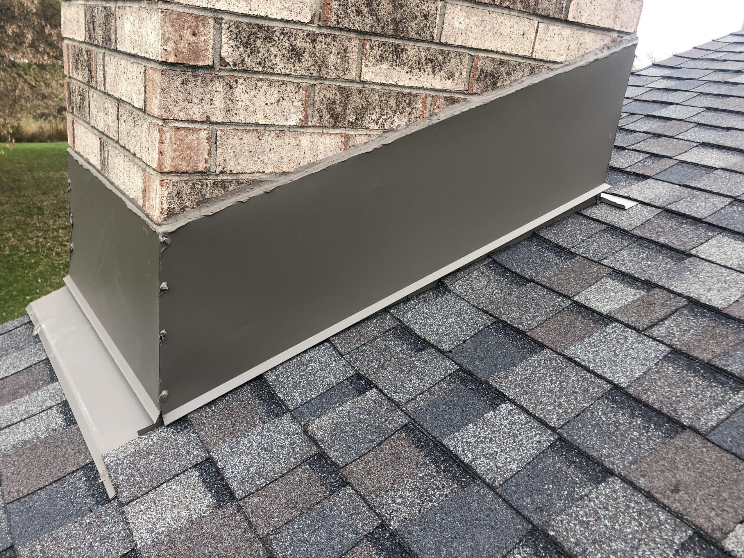 Wisconsin Roofing LLC | Residential | Mequon | Chimney diverter flashing bottom view